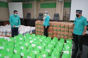 Perumda Tirta Mayang Bagikan 100 Paket Sembako