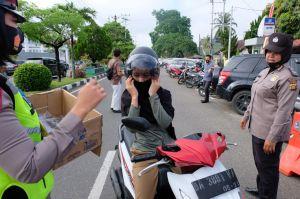 Cegah Virus Covid-19 Polres Bungo Bagikan 1000 Masker gratis